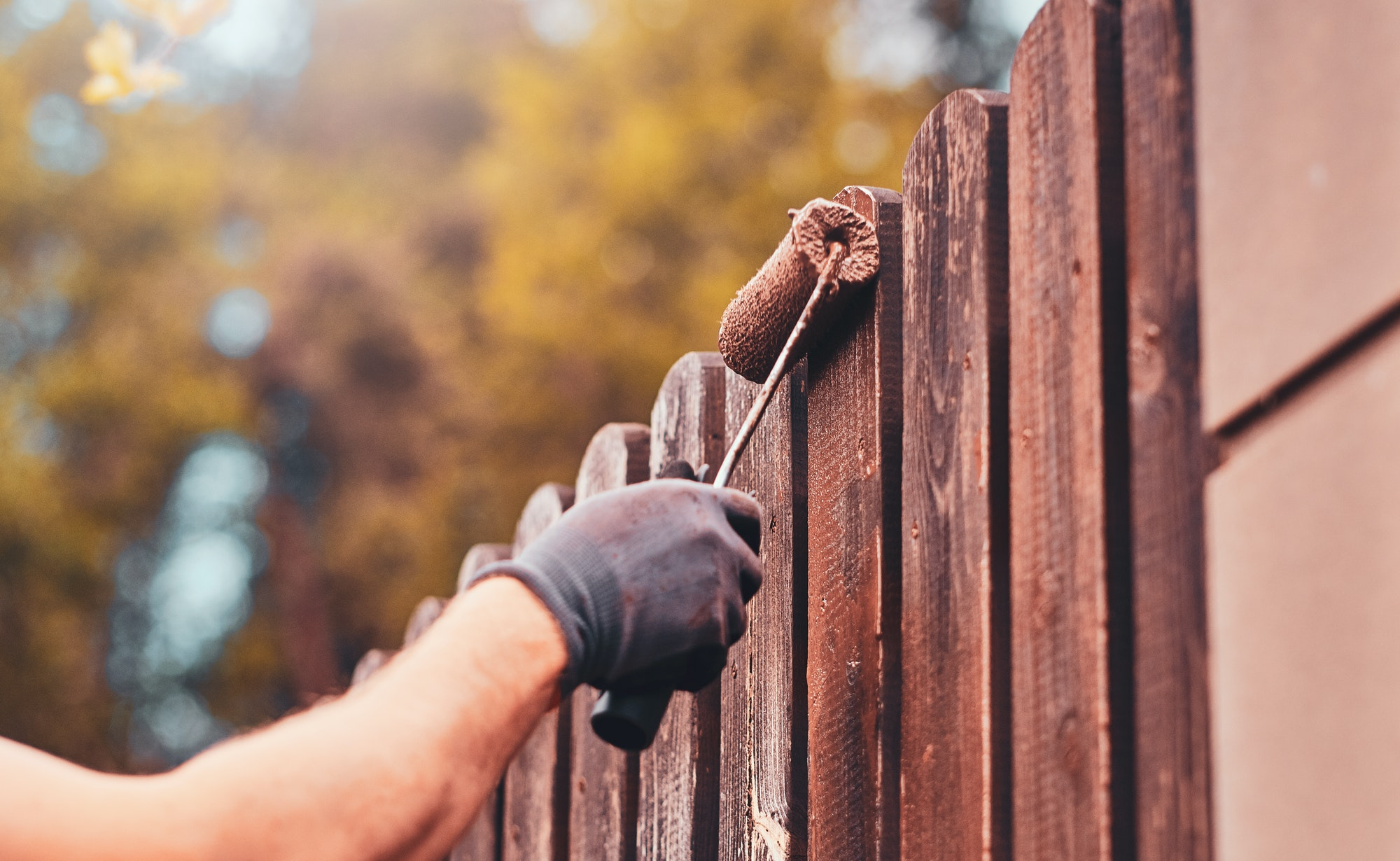 diligent-man-is-painting-fence-with-brush.jpg