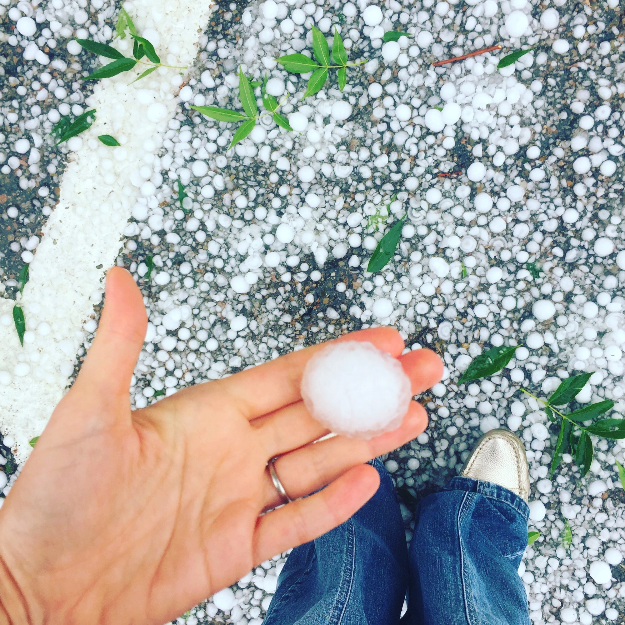 Hail. women's hand to compare the size of hail pic in white green and blue colors