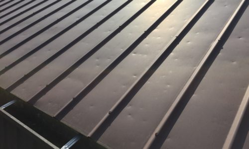 Hail damage to a metal roof